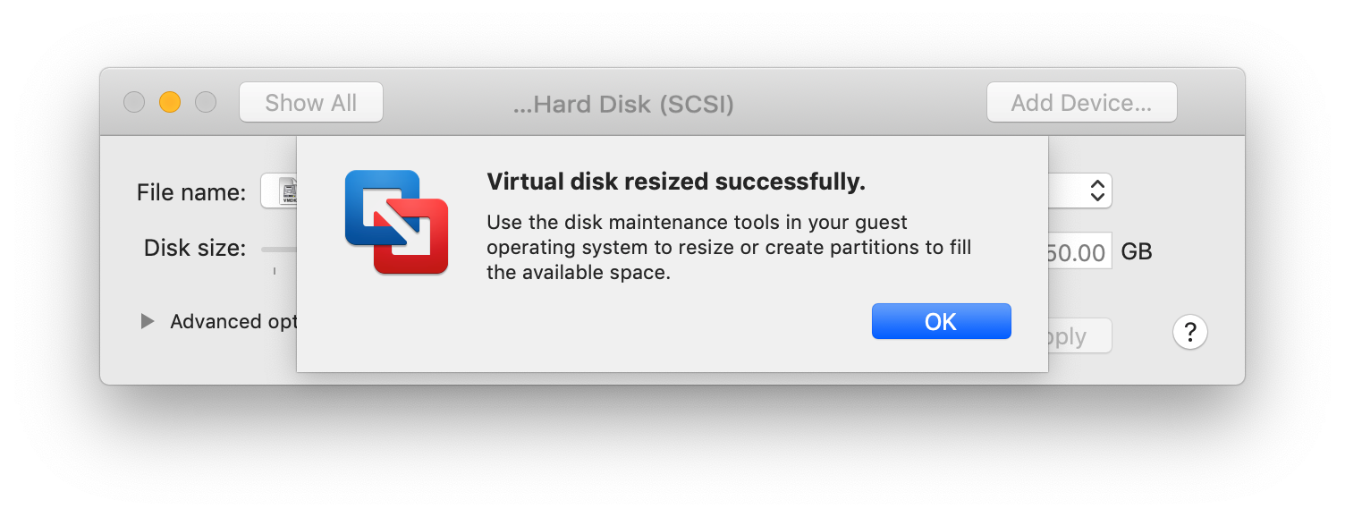 "A VMware Fusion dialog saying ""Virtual disk resized successfully. Use the disk maintenance tools in your guest operating system to resize or create partitions to fill the available space."""