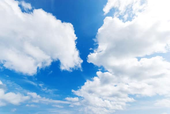 Clouds in front of a blue sky.