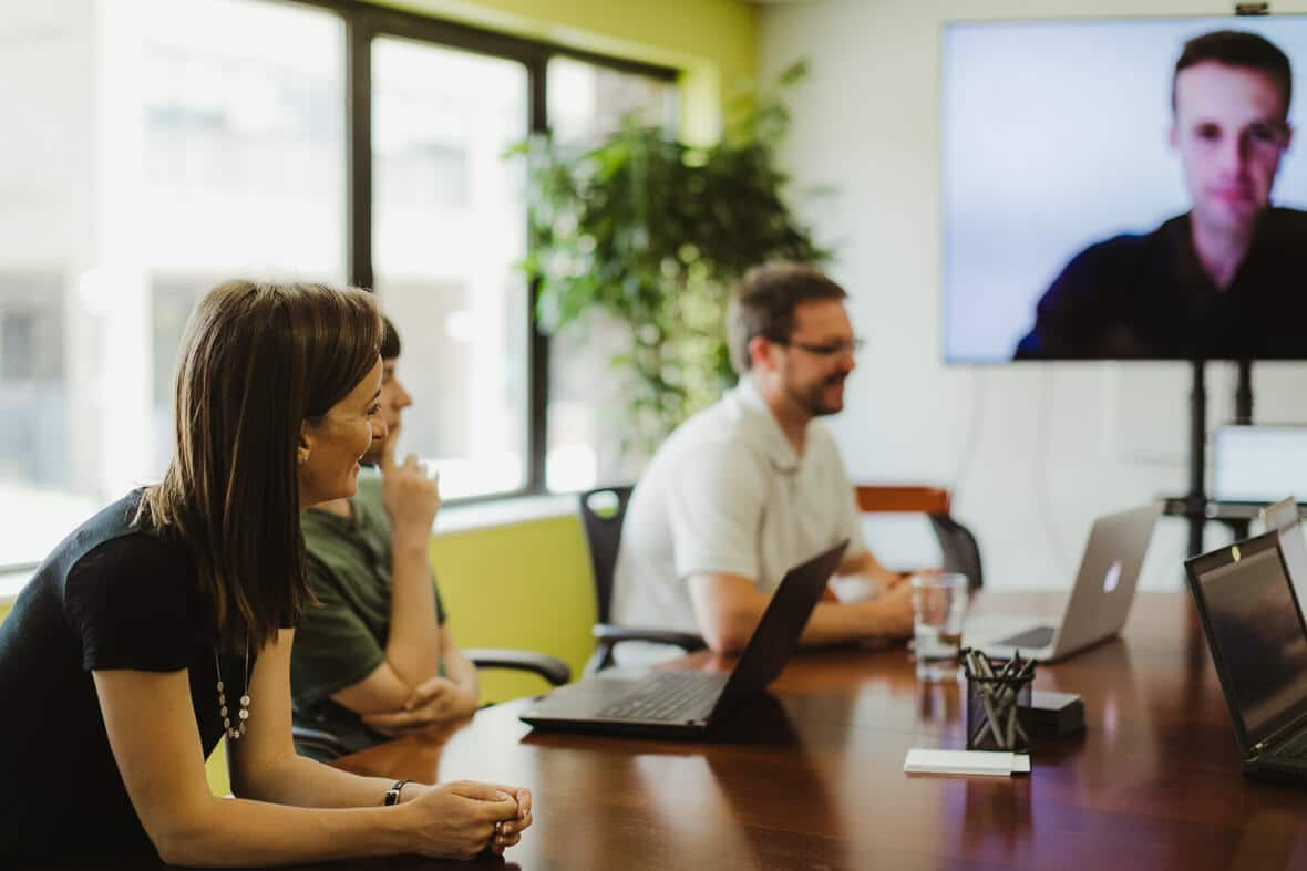 People in a conference room on a video call